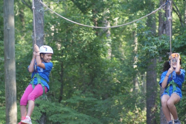 6th grade students enjoy the zip line