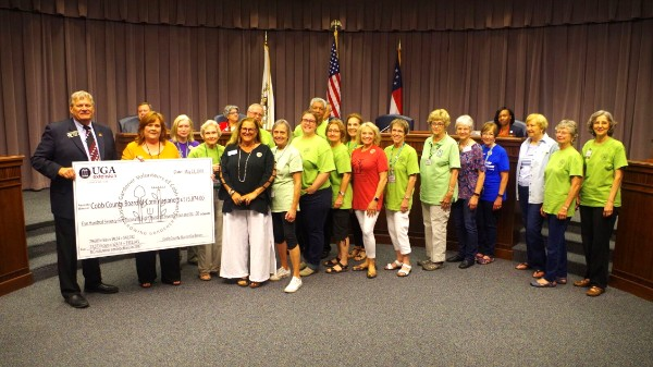 UGA Extension Master Gardener Volunteers of Cobb County Presenting A Honorary Check Valuing Their Volunteer Hours In Cobb At Over $560,000 To The Cobb Board Of Commissioners